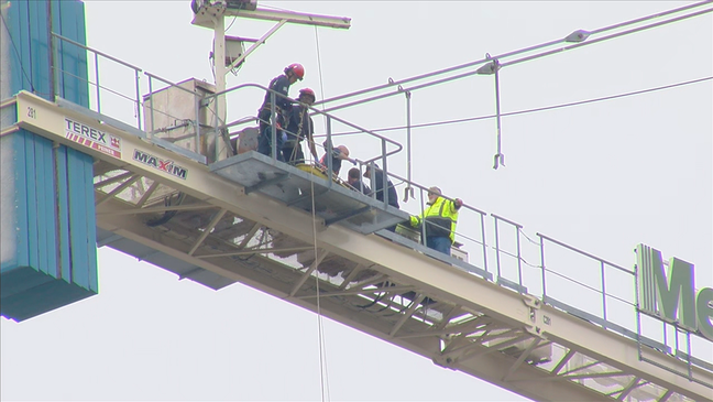 Firefighters rescue injured crane operator nearly 300 feet